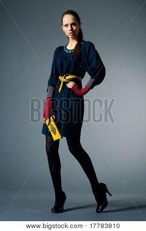 fashion model posing on gray background