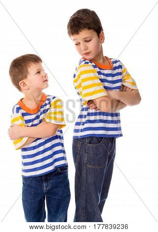 Two conflicting boys standing together isolated on white background