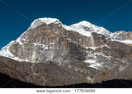 High altitude Peak with ice rocks and snow Walls View in Nepal Mountains
