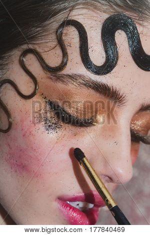 Pretty Girl Putting Holiday Glitter Eyeshadow Makeup