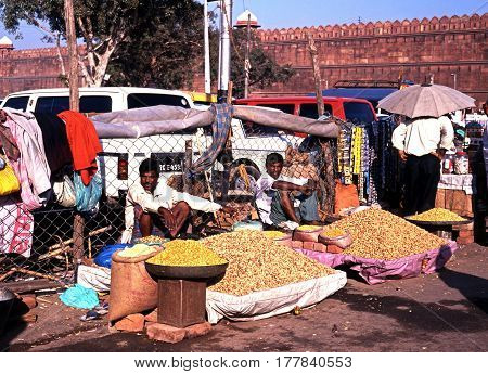 DELHI, INDIA - NOVEMBER 20, 1993 - Roadside snack stalls and seller outside the Red Fort Delhi Delhi Union Territory India, November 20, 1993.