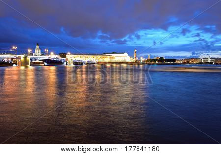 View of the Spit of Vasilyevsky Island and Neva River at night in St.Petersburg Russia.
