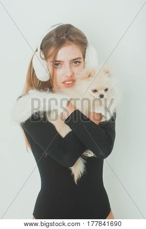 Sexy Pretty Girl With Small Pomeranian Dog In Earmuffs