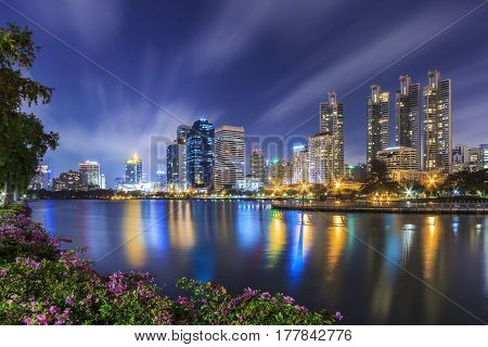 Bangkok city skyline and office buildings in twilight time at Benjakitti Park located in Asoke Bangkok of Thailand.