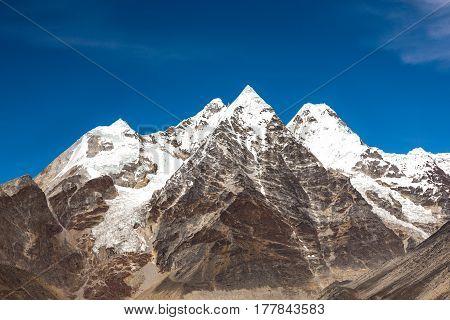 Daylight View of Group of pyramidal Shape high Altitude Mountain Peaks in Nepal Himalaya