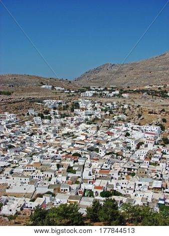 Traditional white houses at the bottom of the mountain on Rodos island