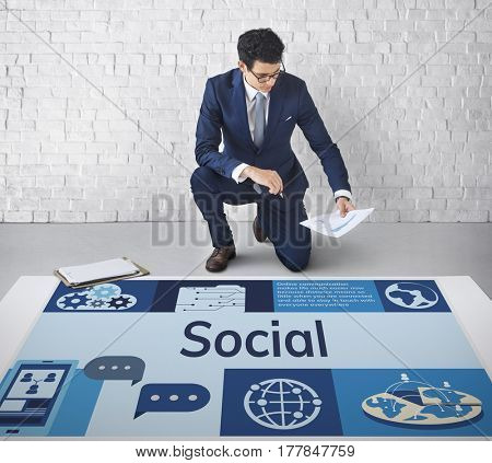 Man working on banner network graphic overlay on floor