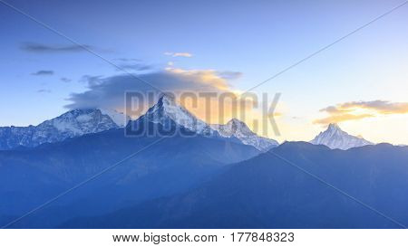 Annapurna mountain range and Machapuchare (Fish tail) with sunrise view from Poonhill famous trekking destination in Nepal. poster
