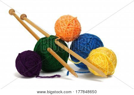 Knitting wool and needles on white background