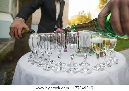 glasses with champagne. catering banquet table. a lot of snacks and canapes.