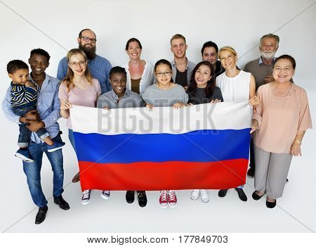 Group of people holding russian flag studio portrait