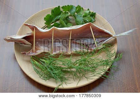 Dried Omul On The Wooden Plate, Decorated With Verdure