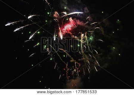 Bright beautiful colorful fireworks. Colored lights in the night sky. New Year holiday wedding.
