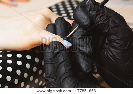 Process of made blue manicure step by step