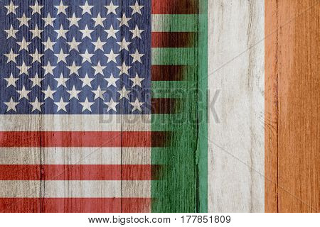 Relationship between the USA and Ireland The flags of USA and Ireland merged on weathered wood