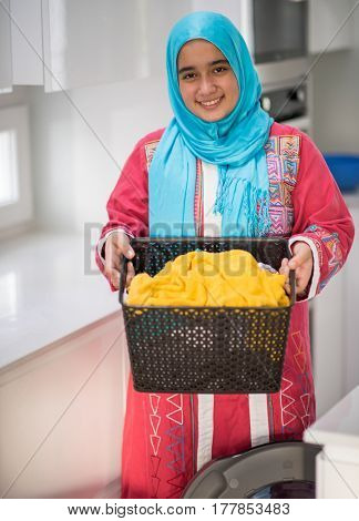 Arabic girl with laundry at modern new home