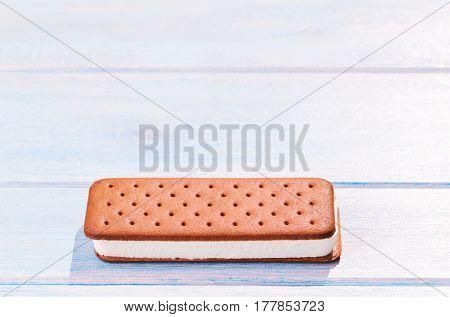 Ice cream sandwich on blue table outdoors