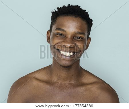 Happiness african man smiling bare chest studio portrait
