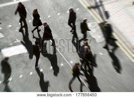 People crossing road at crossing with zoom effect