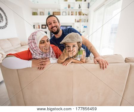 Mother father and son as a happy family at home