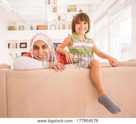 Mom and son on sofa at home
