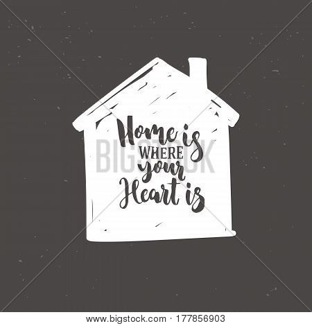 White home icon with lettering Home is where your heart is isolated on dark background. Hand drawn icon. Vector illustration