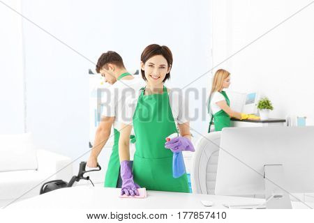 Service team cleaning modern office