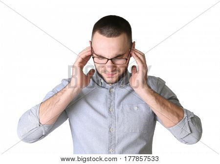 Handsome young man suffering from headache on white background