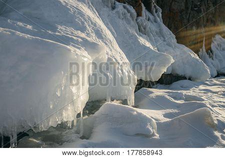 Beautiful rays illuminate the ice floe. Location of the lake is Lake Baikal, Siberia, Russia.