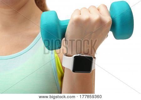 Closeup view of woman with smart watch holding dumbbell in hand