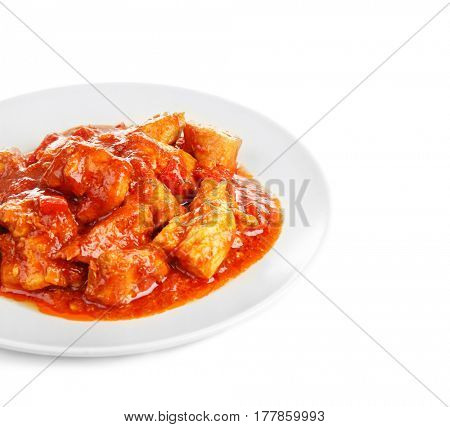 Plate with delicious chicken tikka masala isolated on white