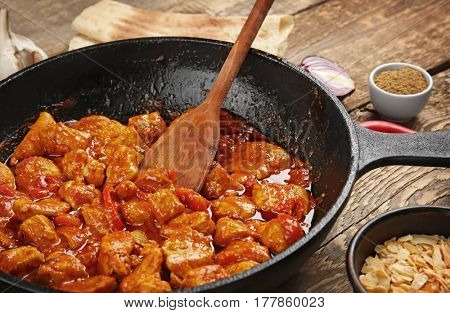 Frying pan with tasty chicken tikka masala, closeup
