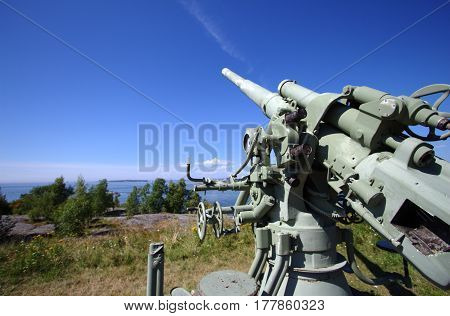 Historical air defense cannon in Suomenlinna. Sunny day with a clear sky