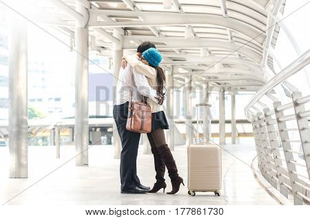 Lovely Couple Hugging At Transport Hubs In The Metropolis.