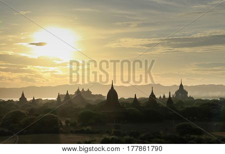 Amazing famous travel and landscape scene of ancient temples and carriages at sunset in Bagan Myanmar. Top of the best destination of asia.