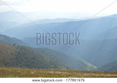 Ridge of Carpathians mountains. Blue color gradient