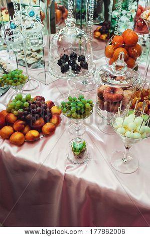 fruits kiwi orange grape peach on the wedding candybar