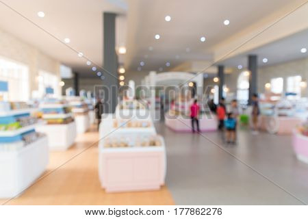 Abstract Blur Background Of People Shopping  In Souvenir Bakery Shop