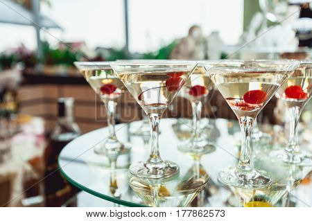 Cold alcoholic margareta cocktail with cherry. Drinks stands on the glass stand.