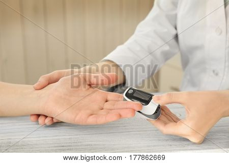 Closeup view of doctor examining woman with heart rate monitor