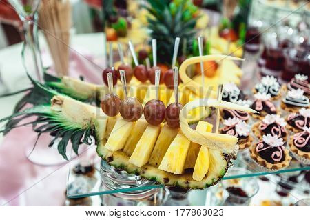 pineapple on the candybar table. a lot of differen sweets