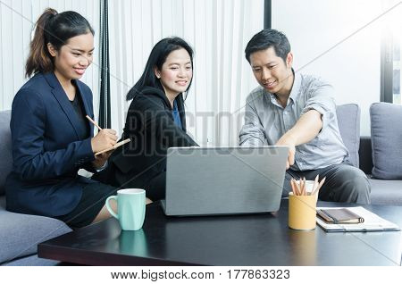 Success business team concept. Group of asian peoples dicussing something while working in office.
