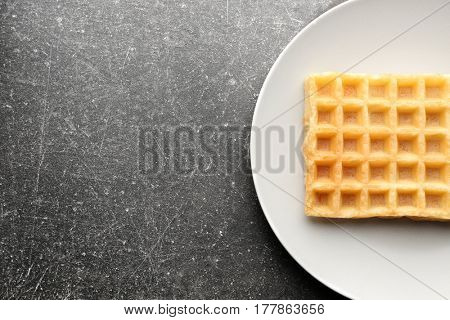 Delicious waffle on white plate