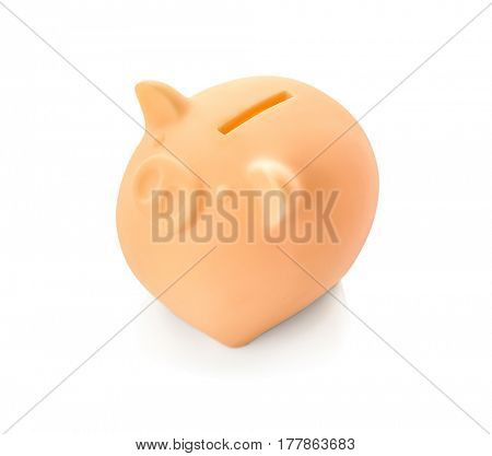 Ceramic piggy bank on white background
