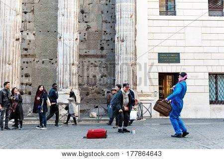 Street Artist On Piazza Di Pietra
