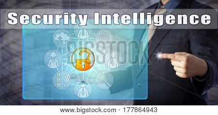 Information technology manager in blue shirt and suit accessing Security Intelligence onscreen. Computer security concept and law enforcement metaphor for cybersecurity internet and data security.