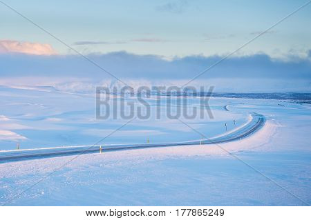 Snowy long road in Iceland ring road