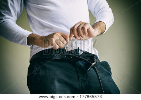 Closeup Of Man Having Condom In Pocket Ready To Use