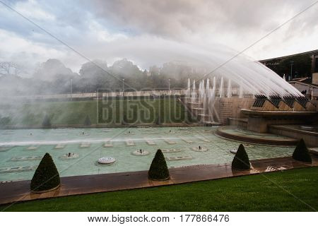 Fountains in Paris at the Trocadero square near the Palace of Chaillot. Travel through Europe. Attractions in France. Grey Sky. Fountains in France