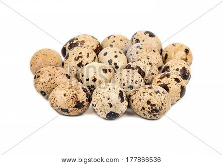 Many raw quail eggs on a white background